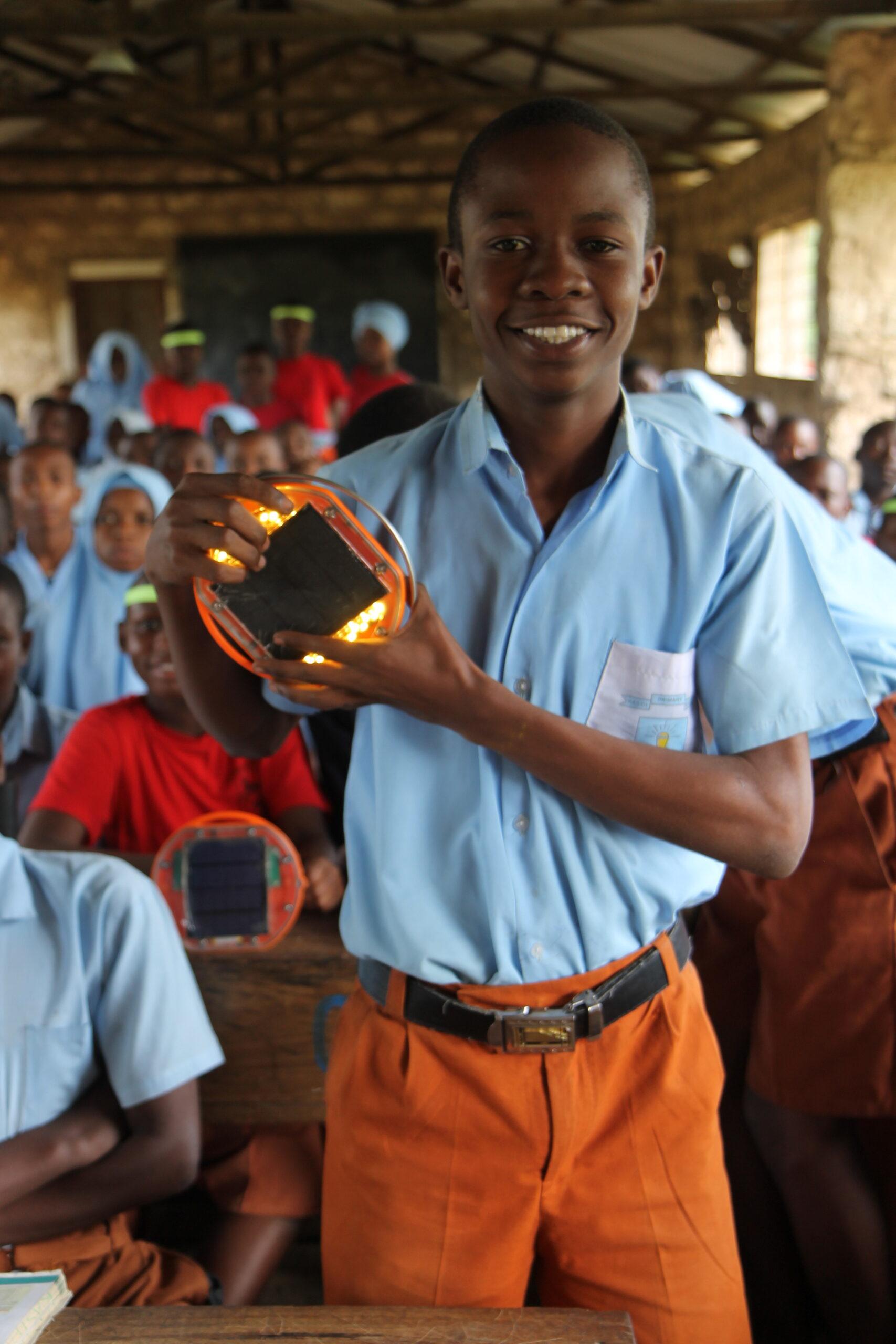 Noel Munga Bokoro with his Mwezi solar light.