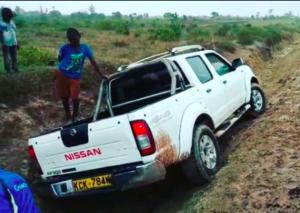 Julia's car, stuck in the mud